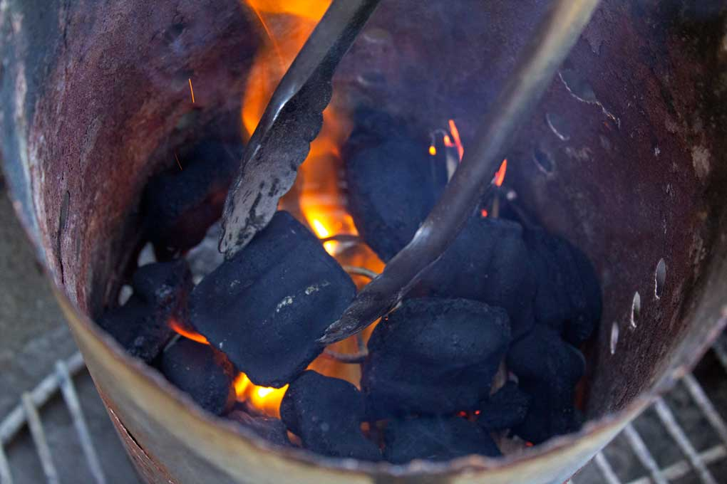 coals inside charcoal chimney