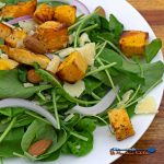 butternut squash arugula salad on plate