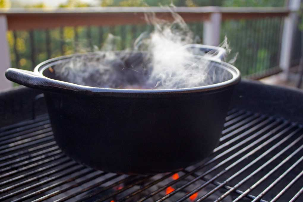 steaming Dutch oven on grill