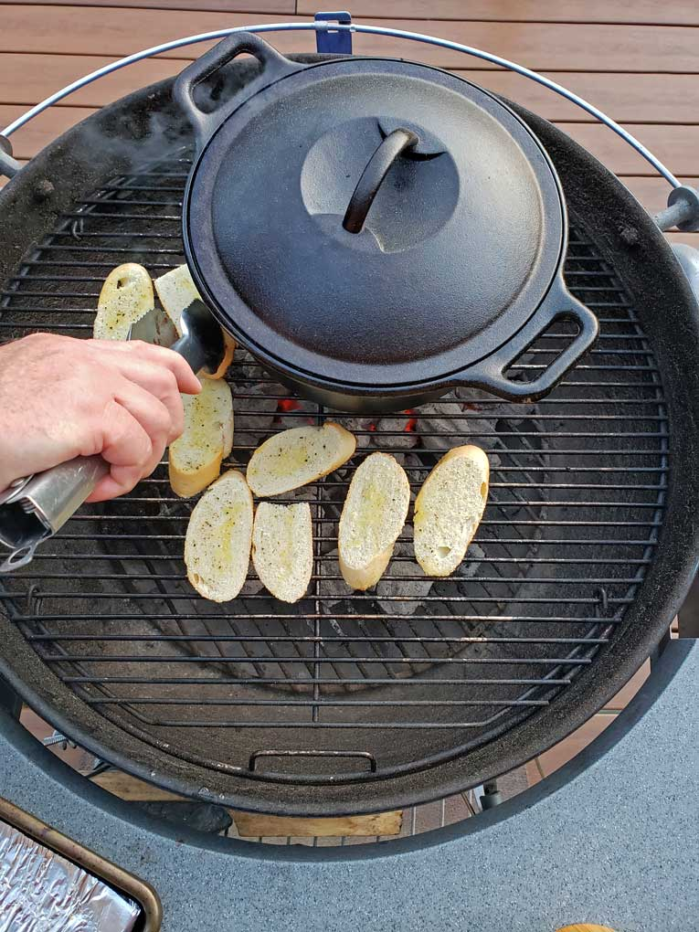 bread on grill with cast iron Dutch oven