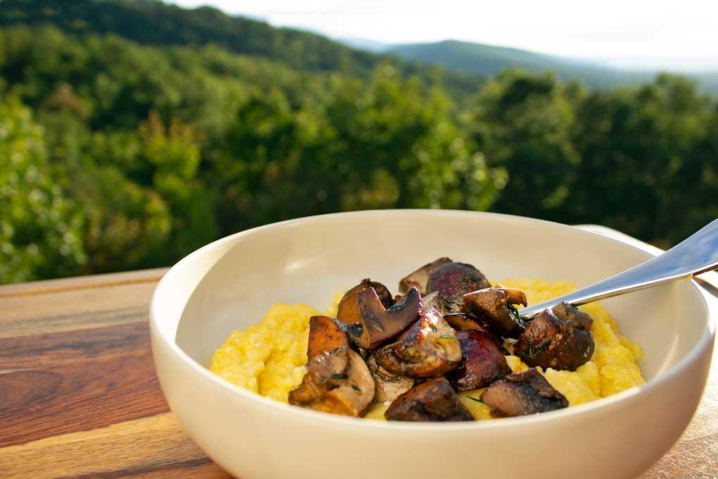 creamy polenta with mushrooms and mountain view