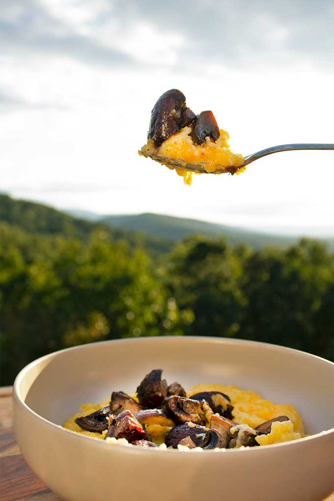 Rich and creamy polenta with sauteed mushrooms is a flavorful quick and easy weeknight dinner. The perfect Meatless Monday comfort food!