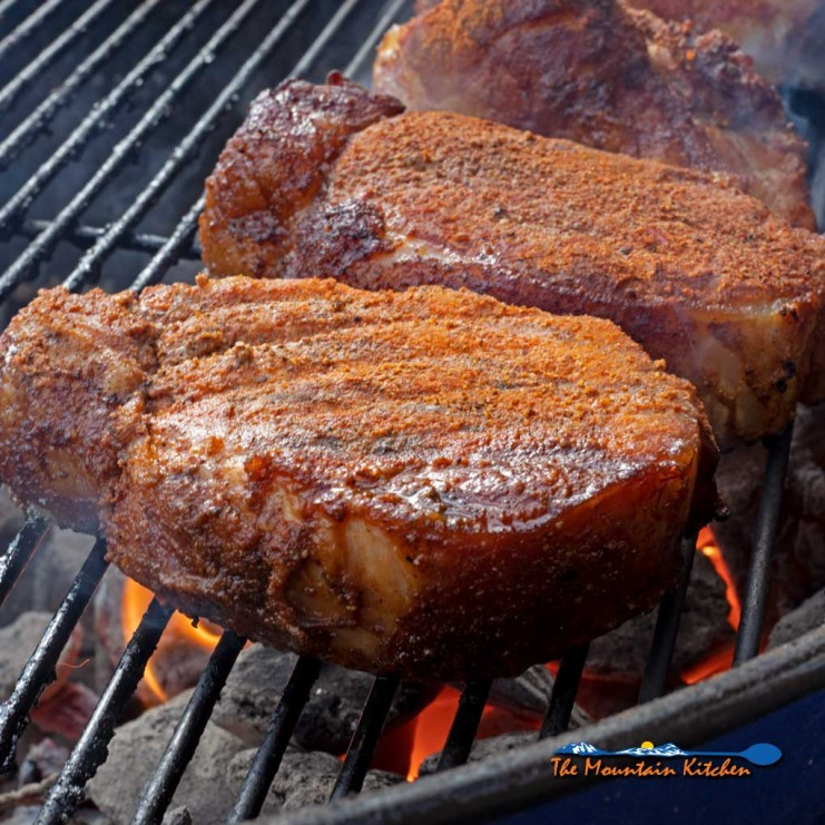 smoked pork chops searing on grill